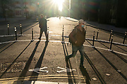 With most Londoners still working from home, a few commuters walk around the widened corner of Threadneedle and Old Board Streets at evening rush-hour during the third lockdown of the Coronavirus in the City of London, the capital's financial district, on 26th February 2021, in London, England.