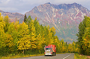 Alaska. Scenic autumn view of a semi-truck traveling south through Broad Pass, south of Cantwell, on the Parks Highway. (car digitally removed from image)