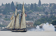 The Lynx, a privateer style schooner fires a canon as it sails into Commencement Bay for the Tall Ships Festival in Tacoma, WA  Thursday, July 3, 2008. (Photo/John Froschauer).