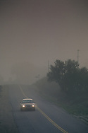 Morning fog over two lane rural country road, Union Road, Paso Robles San Luis Obispo County, California