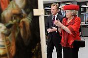 Staatsbezoek van de President van Slowakije , Zijne Excellentie president Ivan Gasparovic en zijn echtgenote Silvia Gasparovicova.<br /> <br /> Statevisit of the President of  Slowakije Ivan Gasparovic and his wife  Silvia Gasparovicova.<br /> <br /> Op de foto/ On the photo: <br /> <br />  Koningin Beatrix en de president van Slowakije Ivan Gasparovic krijgen uitleg in de restauratieafdeling van het Rijksmuseum. <br /> <br /> Queen Beatrix and the President of Slovakia Ivan Gasparovic will visit the restoration department of the Rijksmuseum.