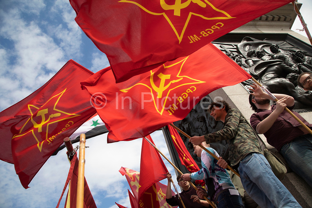 Communist Party of Great Britain red flags during May Day celebrations in London, England, United Kingdom. Demonstration by unions and other organisations of workers to mark the annual May Day or Labour Day. Groups from all nationalities from around the World, living in London gathered to march to a rally in central London to mark the global workers day.