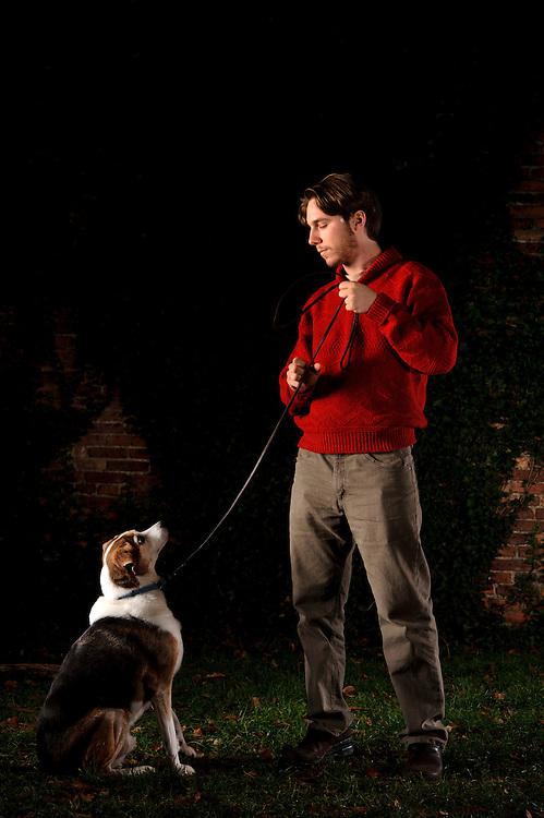 Photo by Matt Roth..Natan Lawson and his dog Melvin Friday, November 25, 2011