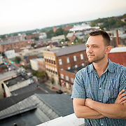 """Former Hagerstown Mayor, David Gysberts atop City Hall with U.S. Route 40 (""""The National Road"""") behind him in downtown Hagerstown, Maryland, on Tuesday, September 26, 2017. The road was originally built in 1810 and connected Cumberland in western Maryland with Baltimore. Originally a District that was mostly rural, but included towns like Frederick and Hagerstown, Maryland's 6th District was redistricted in 2011, combining rural northern Maryland regions with more affluent communities like near Washington D.C. turning the district from Republican to Democrat. <br />  <br /> CREDIT: John Boal for The Wall Street Journal<br /> GERRYMANDER"""