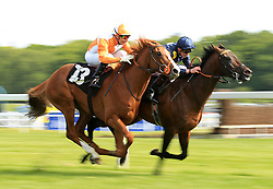 Al Muffrih (right) ridden by James Doyle wins the Martin Gray Celebration British EBF Maiden Stakes from Mini P ridden by Gerald Mosse at Newbury Racecourse.
