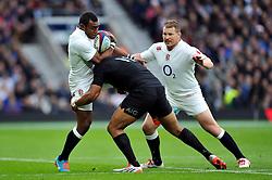 Semesa Rokoduguni of England is tackled by Julian Savea of New Zealand - Photo mandatory by-line: Patrick Khachfe/JMP - Mobile: 07966 386802 08/11/2014 - SPORT - RUGBY UNION - London - Twickenham Stadium - England v New Zealand - 2014 QBE Internationals