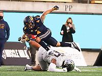 Dec 5, 2020; Berkeley, California, USA; California Golden Bears wide receiver Nikko Remigio (4) jumps over Oregon Ducks linebacker Mase Funa (47) during the second quarter at California Memorial Stadium. Mandatory Credit: Kelley L Cox-USA TODAY Sports