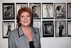 """© under license to London News Pictures. LONDON, 19/05/2011. Cilla Black standing in front of Tommy Nutter photos. Opening of the Tommy Nutter Exhibition """"Rebel on the Row"""" at the Fashion and Textile Museum, London. Photo credit should read BETTINA STRENSKE/LNP"""