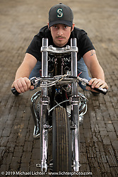 Joey Brookshier, owner of Oak City Speed, a bike shop / DIY shop in Raleigh, here on his 1965 BSA Spitfire drag  bike built in 2-weeks for the Congregation Show in Charlotte, NC. USA. Friday April 13, 2018. Photography ©2018 Michael Lichter.
