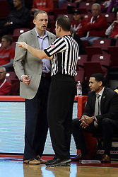 21 November 2015: Dan Muller questions a call with referee Brad Gaston. Illinois State Redbirds host the Houston Baptist Huskies at Redbird Arena in Normal Illinois (Photo by Alan Look)