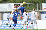 Peterhead's Jason Brown (5) and Cove Rangers' Harry Milne (3) battles for possession, tussles, tackles, challenges,during the Premier Sports Scottish League Cup match between Peterhead and Cove Rangers at Balmoor, Peterhead, Scotland on 17 July 2021.