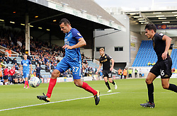 Steven Taylor of Peterborough United is tracked by Reece James of Wigan Athletic - Mandatory by-line: Joe Dent/JMP - 23/09/2017 - FOOTBALL - ABAX Stadium - Peterborough, England - Peterborough United v Wigan Athletic - Sky Bet League One