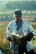 William L. Rathje, professor of archeology at the University of Arizona studies garbage as insight into human behavior.  He reads a 20 year old newspaper from the Fresh Kills landfill.