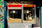 A man scoops fresh popcorn from a brightly coloured popcorn dispenser on the 25th February 2019 in Brixton in South London in the United Kingdom. A new English record was set on this day with temperatures rising to 20.1C in south-west London. It is the first time a temperature of over 20C has been recorded in England during winter.