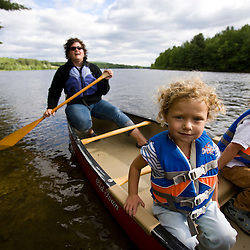 A young family canoes on the Androscoggin River in Turner, Maine. (MR)