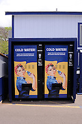 """Vending machines featuring a modified reproduction of J. Howard Miller's famous """"We Can Do It"""" poster, often associated with the iconic """"Rosie the Riveter"""" character. USS Arizona Memorial and Visitors' Center"""
