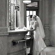Bride and Groom at Grand Central Terminal, NYC train ticket window in Black and White