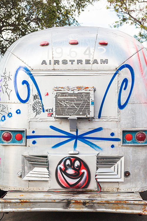 Painted and customized by pop artist Kenny Scharf is this vintage Airstream trailer at Miami's outdoor street art museum known as The Wynwood Walls. Scharf calls his creation the  Cosmic Carestream