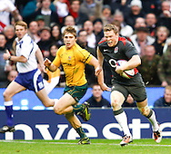 Chris Ashton of England runs in his second try past James O'Connor during the Investec series international between England and Australia at Twickenham, London, on Saturday 13th November 2010. (Photo by Andrew Tobin/SLIK images)