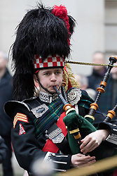 © Licensed to London News Pictures. 20/01/2018. London, UK. Student members of the Pipes and Drums Band from Gordon's School in Surrey lead the annual parade to the national monument to General Gordon of Khartoum. The school is the only one in the country permitted to march along Whitehall. Students are dressed in their ceremonial Blues uniform and make their way down Whitehall before arriving at the statue of General Gordon for a memorial service to commemorate his death. Photo credit: Vickie Flores/LNP