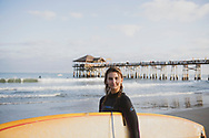 Cocoa Beach, Florida - December 15, 2020: Portrait of Shelby, on her way home after surfing at the Cocoa Beach Pier.