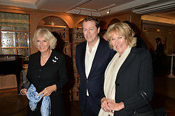 Left to right, HRH The DUCHESS OF CORNWALL, her son TOM PARKER BOWLES and ANNABEL ELLIOT at a party to celebrate the publication of 'Let's Eat meat' by Tom Parker Bowles held at Fortnum & Mason, Piccadilly, London on 21st October 2014.