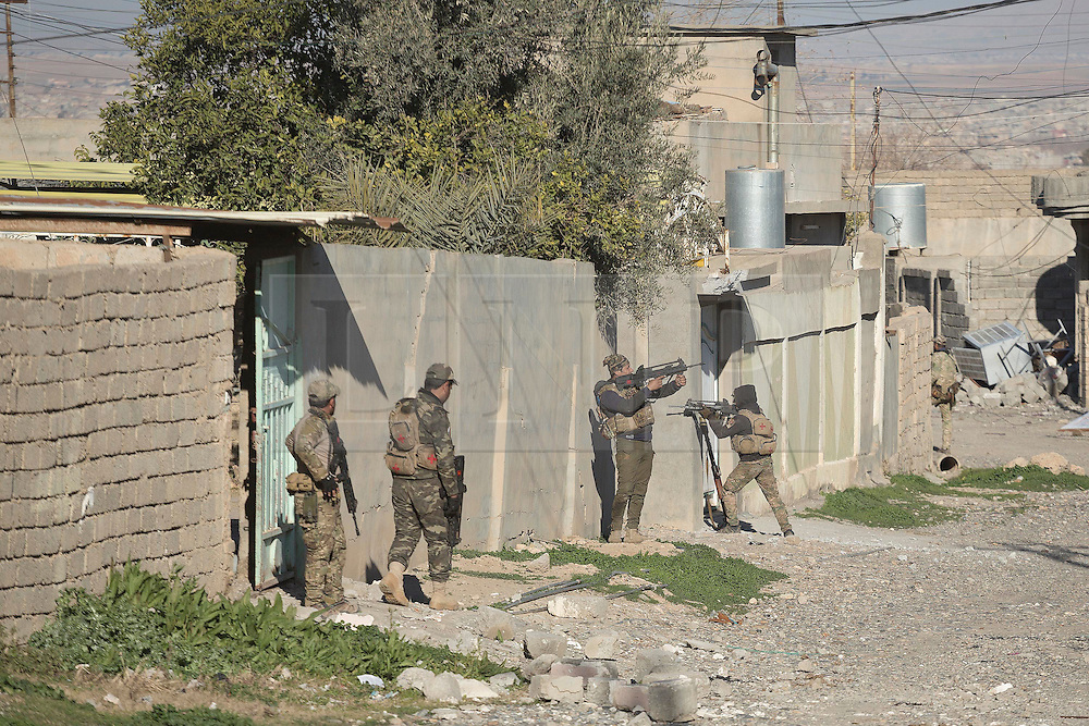 Licensed to London News Pictures. 20/02/2017. Albu Saif, Iraq. Iraqi Emergency Response Soldiers clear houses in the village of Albu Saif during the offensive to retake western Mosul from Islamic State militants.<br /> <br /> The settlement of Albu Saif is located on high ground overlooking Mosul Airport and as such is a strategic point that needs to be taken as part of the operation to retake the western side of Mosul. Photo credit: Matt Cetti-Roberts/LNP