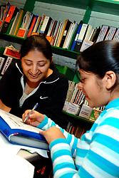 Gujarati girls at a homework club for refugees Bradford Yorkshire UK