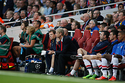 27.08.2013, Emirates Stadion, London, ENG, UEFA CL Qualifikation, FC Arsenal vs Fenerbahce Istanbul, Rueckspiel, im Bild Arsenal's Manager Arsene Wenger sits in the dug out during the UEFA Champions League Qualifier second leg match between FC Arsenal and Fenerbahce Istanbul at the Emirates Stadium, United Kingdom on 2013/08/27. EXPA Pictures © 2013, PhotoCredit: EXPA/ Mitchell Gunn<br /> <br /> ***** ATTENTION - OUT OF GBR *****