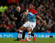 Anthony Martial of Manchester United tackles Rodrigo of Manchester City during the Premier League match at Old Trafford, Manchester. Picture date: 8th March 2020. Picture credit should read: Darren Staples/Sportimage