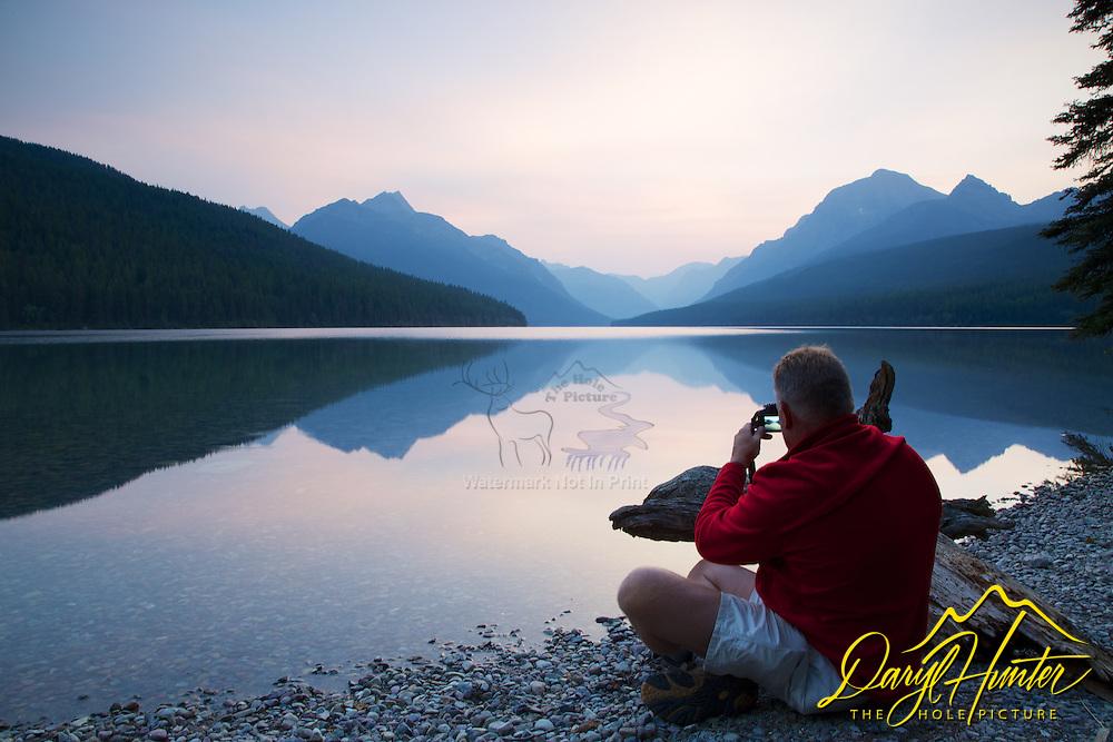 Photographer, Sunrise, reflection, Bowman Lake, Glacier National Park