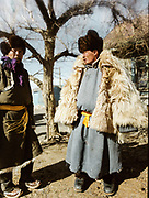 A man dressed up in furry coat at a camel festival, in Bulgan. Road trip with a Jeep in the Gobi region.