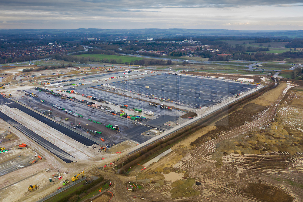 © Licensed to London News Pictures. 06/12/2020. Ashford, UK. Work continues to complete the Ashford Brexit lorry overflow park in Kent. After rain delays, work on the massive site is taking place overnight. The lorry park, located off junction 10a of the M20 motorway, is expected to be able to house 1700 lorries that may face delays getting to the Eurotunnel terminal at Folkstone & Dover port as the Brexit transition period ends on December 31st. Photo credit: Peter Macdiarmid/LNP