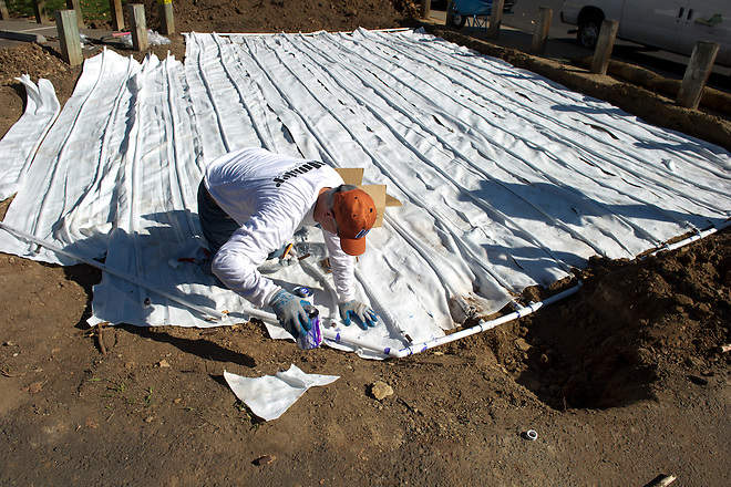 Danny Motylenski  installs a subsurface irrigation system Monday, October 30, 2012 at Gibbons Park in Carmichael, CA. The system uses a polypropylene fleece material to reduce the amount of water used for irrigation. The park district plans to cover the 1000 square foot section with a native turf sod after installation of the new technology.  Carl Costas / The California Department of Water Resources, FOR EDITORIAL USE ONLY