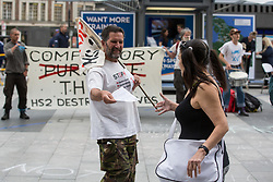 """London, UK. 5th August, 2021. Stop HS2 campaigners carry out outreach activities directly in front of a HS2 Routewide Roadshow at Kings Cross Square. There have been increasing doubts regarding the viability of the northern section of the HS2 high-speed rail link since a recent report published by the Infrastructure and Projects Authority gave Phase 2b the lowest 'red' rating, indicating that successful delivery of the scheme """"appears to be unachievable""""."""