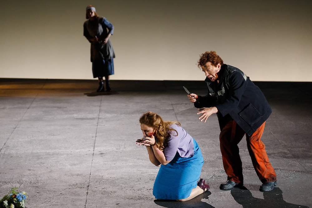 """LONDON, UK, 21 June, 2016. Left to right: Claire Mitcher (as Barena), Laura Wilde (as Jenufa) and Peter Hoare (as Laca Klemen)  rehearse for the revival of director David Alden's production of Janacek's opera """"Jenufa"""" at the London Coliseum for the English National Opera. The production opens on 23 June. Photo credit: Scott Rylander."""