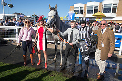 Cool Mix and Liam Quinlan after winning The Ayrshire Magazine Racing Excellence Hands & Heels Handicap Hurdle at the Coral Scottish Grand National 2018 meeting at Ayr Racecourse.
