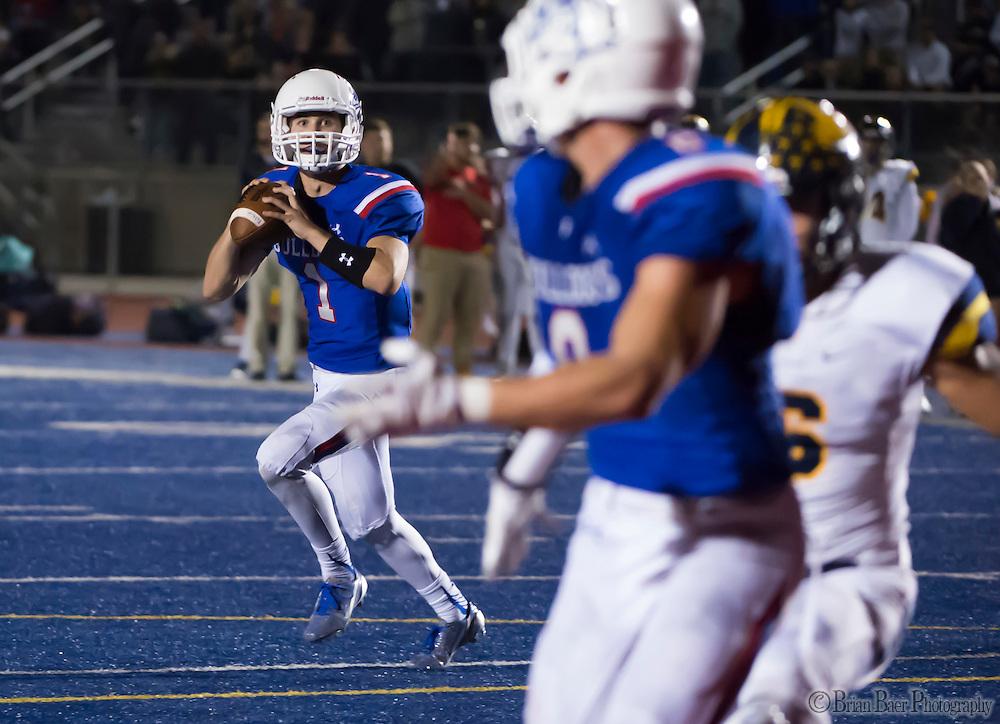 Folsom High School Bulldogs Joe Curry (1), passes the ball during the fourth quarter as the Folsom High School Bulldogs varsity football team host the Oak Ridge High School Trojans,  Friday Nov 4, 2016.<br /> photo by Brian Baer