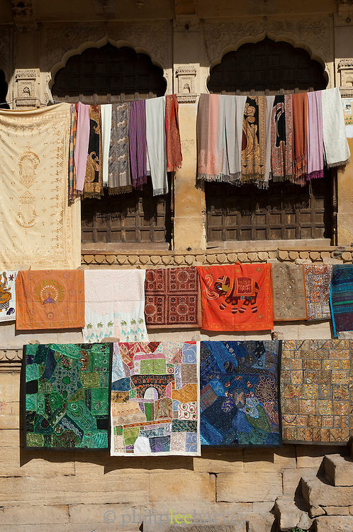 Fabrics and textiles for sale at Jaisalmer Fort, the 'Golden Fort'. It is one of the largest forts in the world. Jaisalmer, Rajasthan, India