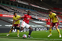 Football - 2020 / 2021 Premier League - Manchester United vs Burnley - Old Trafford<br /> <br /> Paul Pogba of Manchester United and Dwight McNeil and Ashley Westwood of Burnley at Old Trafford<br /> <br /> Credit COLORSPORT/LYNNE CAMERON