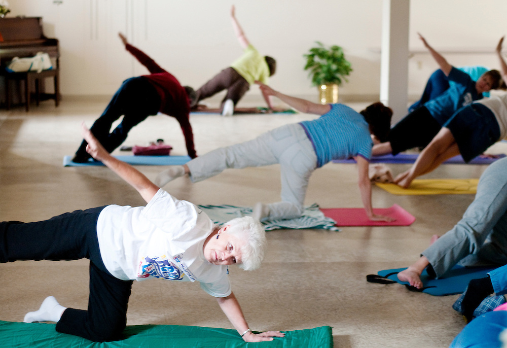 Matt Dixon | The Flint Journal..Bottom left, Mary Parks, 74, of Flushing Township participates in a yoga class with others at the Flushing Senior Center Monday evening. According to new Census data released this week, Genesee County is getting older.