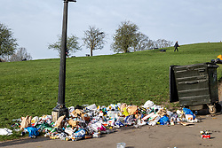 © Licensed to London News Pictures. 31/03/2021. London, UK. Huge amounts of rubbish is left scattered around Primrose Hill in North West London  this morning after sunbathers and picnickers enjoy the hottest day of the year yesterday as weather forecasters predict further highs of 23c in the South East today. Photo credit: Alex Lentati/LNP