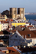 Cathedral of Sé de Lisboa and part of the Baixa district, seen from the walkway at the top of Elevador de Sta. Justa. This lift, built in 1902 with 45 metres tall, links the higher districts with Baixa in the hill directly opposite to the castle, in central Lisbon