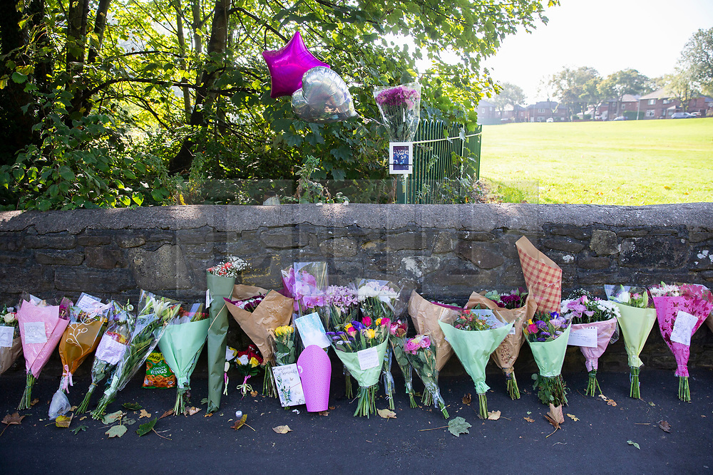 © Licensed to London News Pictures. 21/09/2020. St Helens, UK. Tributes are left along Blackbrook Road in St Helens for 14-year-old girl killed in a horrific collision on Saturday [19/09/2020]. Two men, aged 18 and 19, were arrested on suspicion of causing death by dangerous driving. Photo credit: Kerry Elsworth/LNP