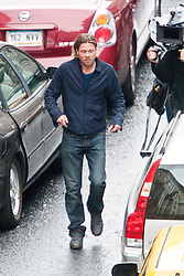 """Day two of filming. Brad Pitt gets a fright from the gun blast on the set of the movie """"World War Z"""" being shot in the city centre of Glasgow. The film, which is set in Philadelphia, is being shot in various parts of Glasgow, transforming it to shoot the post apocalyptic zombie film.."""