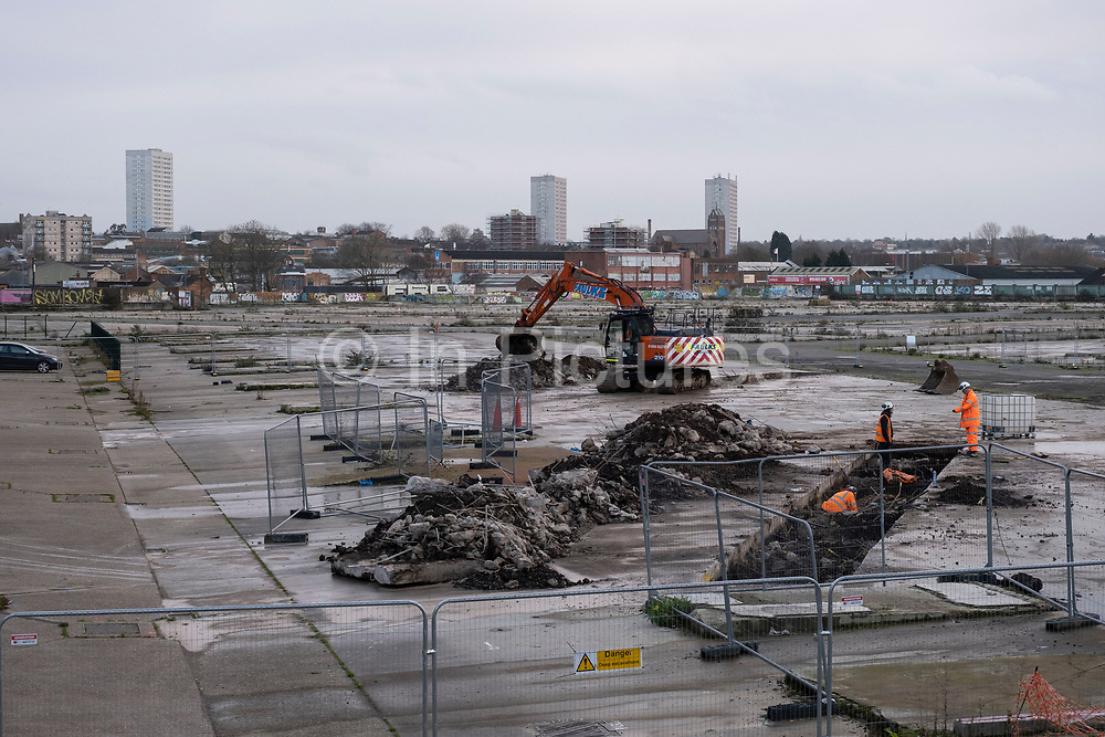 Workers seen undertaking unspecified preliminary construction work on the site of the empty area of the old Birmingham Wholesale Market Precinct, in the city centre on 14th December 2020 in Birmingham, United Kingdom. The site, which was once home to a bustling market has been desolate for years, but has now been ear-marked after it was announced that the Birmingham 2022 Commonwealth Games was going to use the site for events. (photo by Mike Kemp/In Pictures via Getty Images)