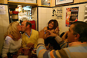 """A couple kisses at """"Tasca do Chico"""", one of the typical spots were to see live perfomances of Fado music and were the audience can spontaneously participate and also ask to sing. It is located in  Bairro Alto neighborhood."""