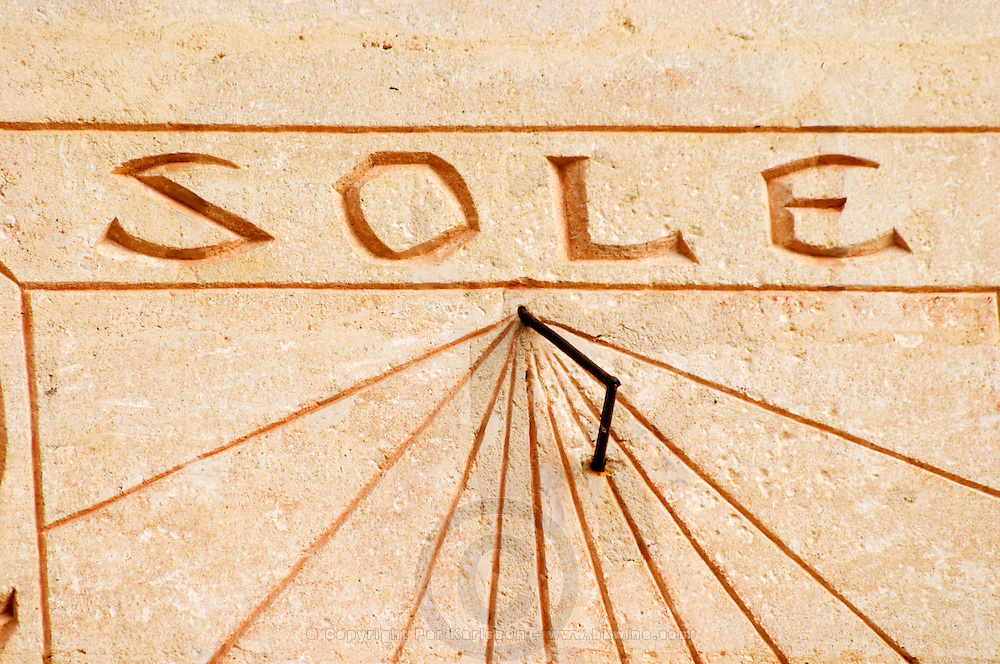 The sun dial on the wall of the building with the carved stone inscription 'Sine Sole Nihil', without the sun there is nothing. Detail showing just the text 'sole' Chateau Mourgues du Gres Grès, Costieres de Nimes, Bouches du Rhone, Provence, France, Europe