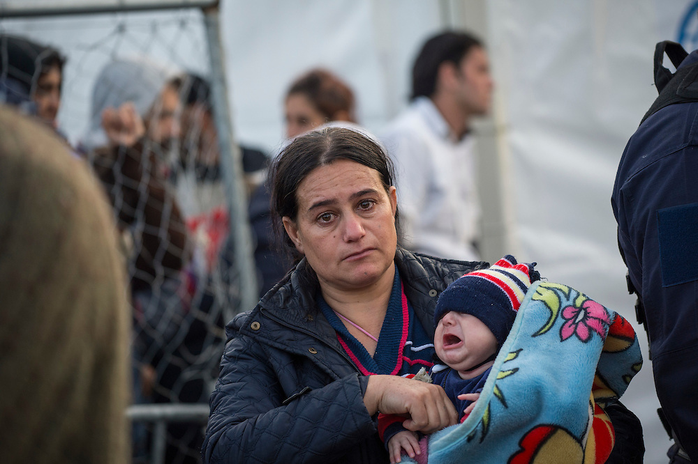 March 5, 2016 - Idomeni, Greece:  An exhausted woman is crying, after hours of waiting at the  Idomeni border crossing in Greece just before crossing to Macedonia. 12,000 refugees are stuck here after Macedonia closed the border. New arrivals come in every day, making living conditions more and more difficult. (Steven Wassenaar/Polaris)