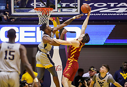 Mar 6, 2019; Morgantown, WV, USA; West Virginia Mountaineers forward Derek Culver (1) defends a shot from Iowa State Cyclones forward Michael Jacobson (12) during the second half at WVU Coliseum. Mandatory Credit: Ben Queen-USA TODAY Sports